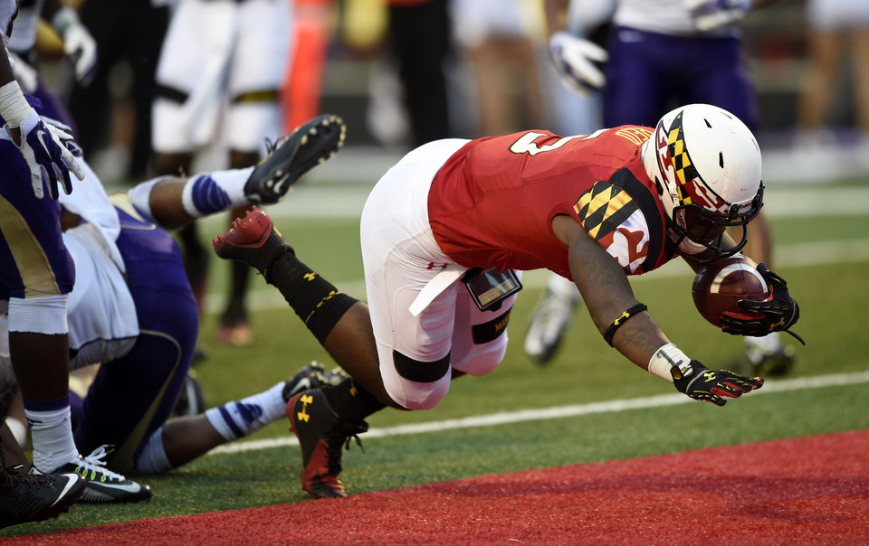 Photo - Maryland running back Albert Reid (5) scores a touchdown against James Madison during the second half of an NCAA college football game, Saturday, Aug. 30, 2014, in College Park, Md. Maryland won 52-7. (AP Photo/Nick Wass)