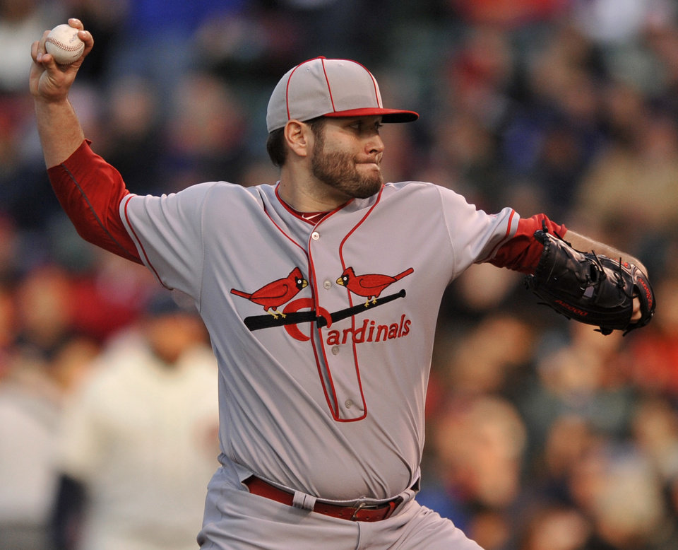 Photo - St. Louis Cardinals starter Lance Lynn delivers a pitch during the first inning of baseball game against the Chicago Cubs in Chicago, Sunday, May 4, 2014. (AP Photo/Paul Beaty)