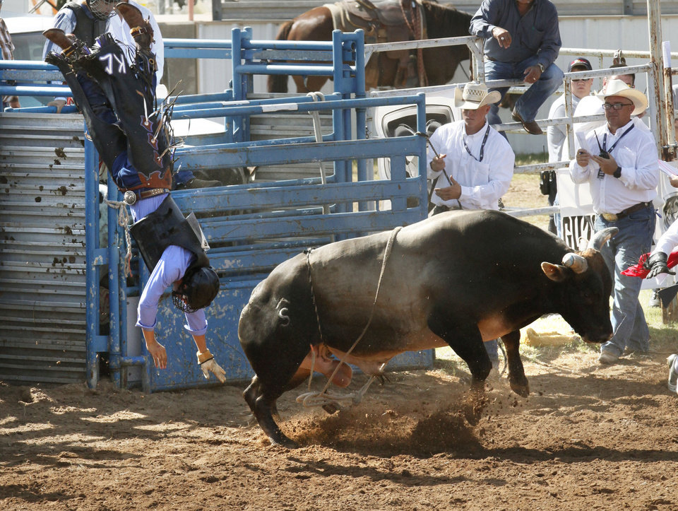 Braden Crawford, from Guthrie, OK, gets thrown from his bull during the bull riding event during Tuesday's performances at the International Youth Finals Rodeo at the Shawnee Heart of Oklahoma Exposition Center in Shawnee, OK, Tuesday, July 8, 2014,  Photo by Paul Hellstern, The Oklahoman