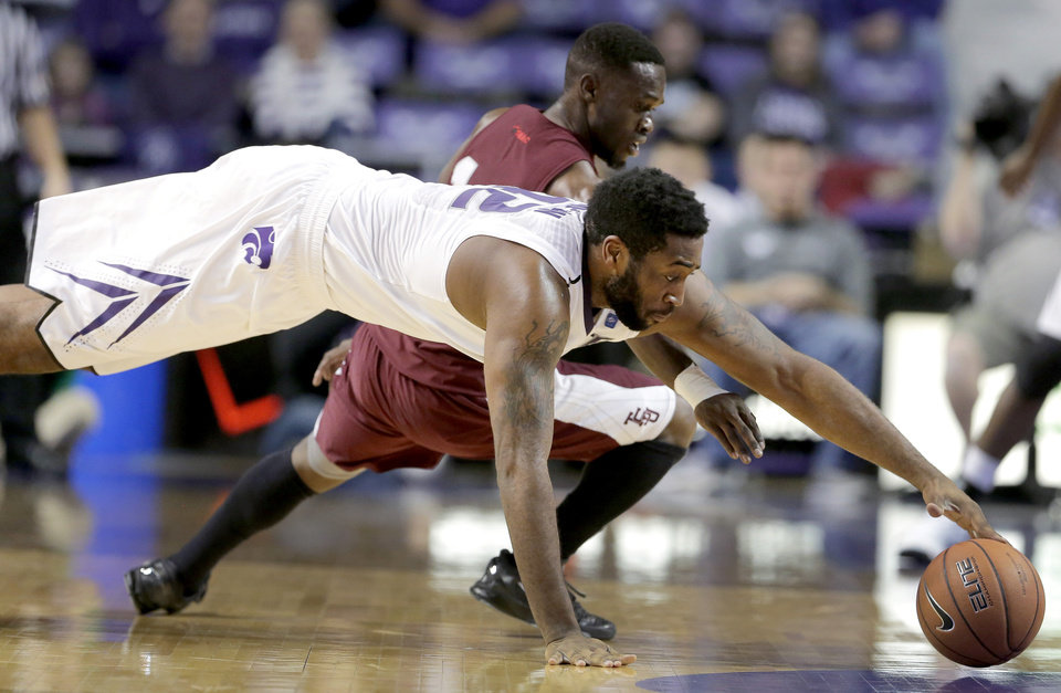 Kansas State forward Thomas Gipson, front, beats Texas Southern guard Raymond Penn to a loose ball during the first half of an NCAA college basketball game Tuesday, Dec. 18, 2012, in Manhattan, Kan. (AP Photo/Charlie Riedel)