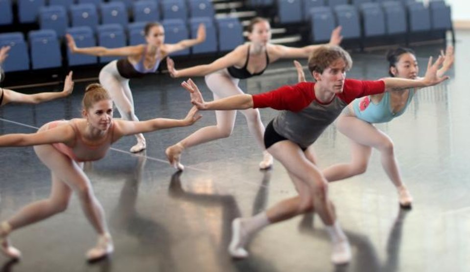 Photo -  Oklahoma City Ballet soloist Walker Martin, center, rehearses with his fellow dancers April 8 at the Susan E. Brackett Dance Center. [Doug Hoke/The Oklahoman]