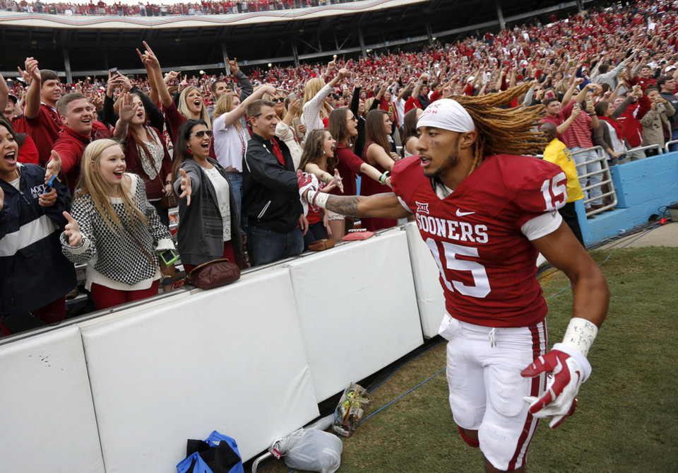 Photo - Oklahoma's Zack Sanchez (15) celebrates after OU's 31-26 win in the Red River Showdown college football game between the University of Oklahoma Sooners (OU) and the University of Texas Longhorns (UT) at the Cotton Bowl in Dallas on Saturday, Oct. 11, 2014. 