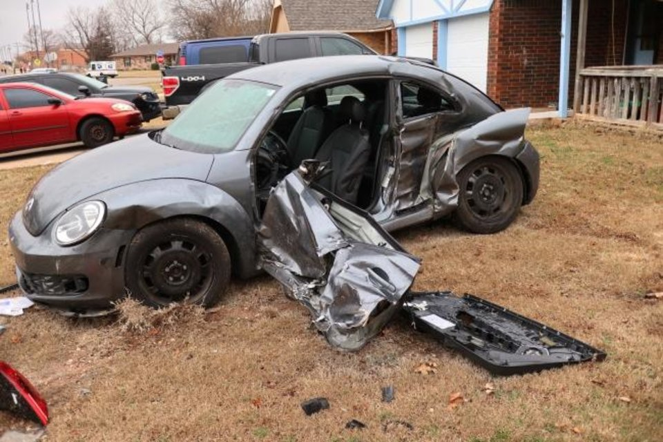 Photo -  Volkswagen Beetle that was one of the vehicles hit in Moore by the pickup driven by Max Leroy Townsend, 57, on Monday.   [Photo by Doug Hoke/The Oklahoman]