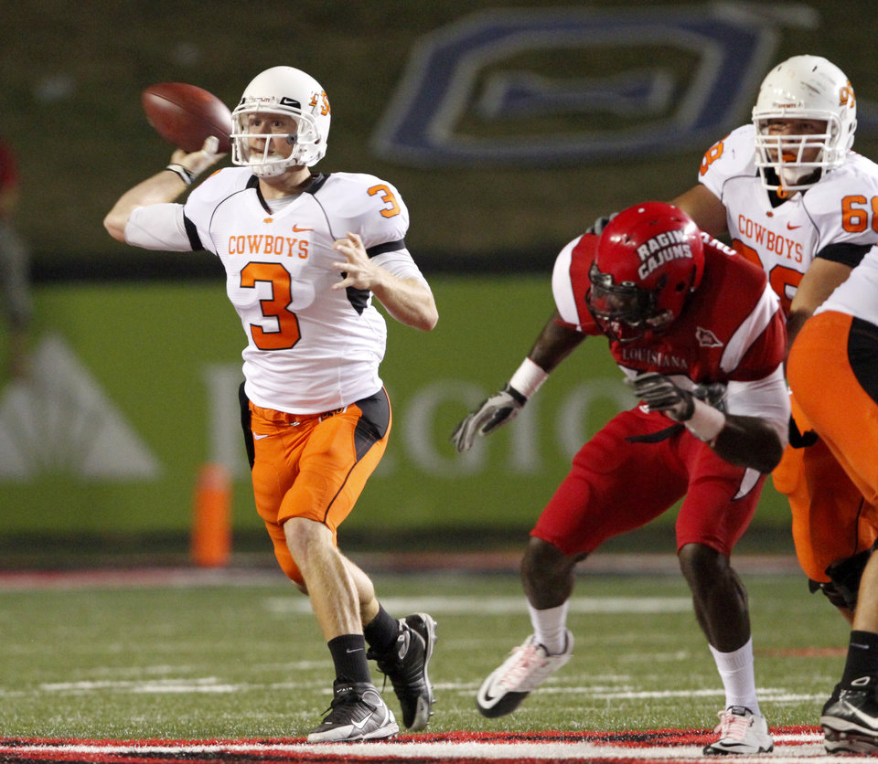 OSU's Brandon Weeden throws a pass during the football game between the University of Louisiana-Lafayette and Oklahoma State University at Cajun Field in Lafayette, La., Friday, October 8, 2010. Photo by Bryan Terry, The Oklahoman