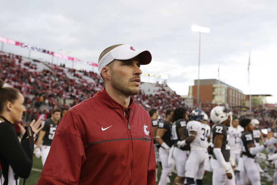 Photo - Washington State defensive coordinator Alex Grinch walks on the field after an NCAA college football game against Nevada in Pullman, Wash., Saturday, Sept. 23, 2017. (AP Photo/Young Kwak)
