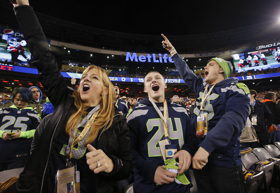 Photo - Seattle Seahawks fans cheer before the NFL Super Bowl XLVIII football game between the Seattle Seahawks and the Denver Broncos Sunday, Feb. 2, 2014, in East Rutherford, N.J. (AP Photo/Kathy Willens)