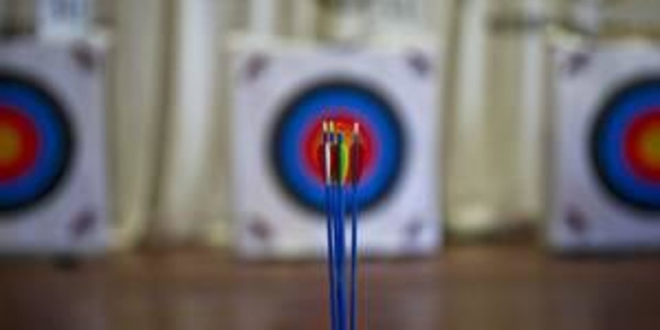 Arrows sit in a stand at the 10-meter distance during the Archery in the Schools Regional Shoot last month at State Fair Park. By Chris Landsberger, The Oklahoman    <strong></strong>