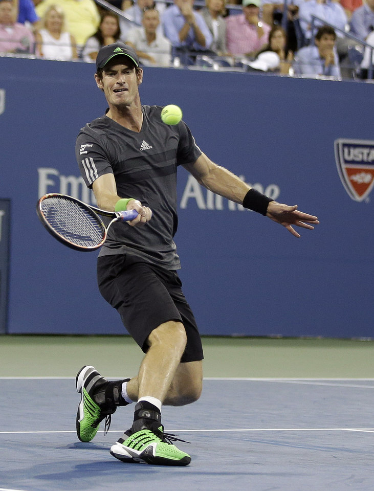 Photo - Andy Murray, of Britain, returns a shot to Novak Djokovic, of Serbia, during the quarterfinals of the U.S. Open tennis tournament Wednesday, Sept. 3, 2014, in New York. (AP Photo/Darron Cummings)