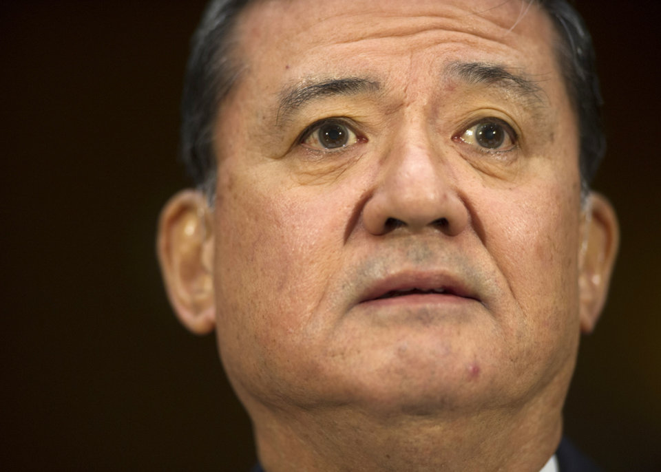 Photo - Veterans Affairs Secretary Eric Shinseki listens on Capitol Hill in Washington, Thursday, May 15, 2014, while testifying before the Senate Veterans Affairs Committee hearing to examine the state of Veterans Affairs health care. (AP Photo/Cliff Owen)