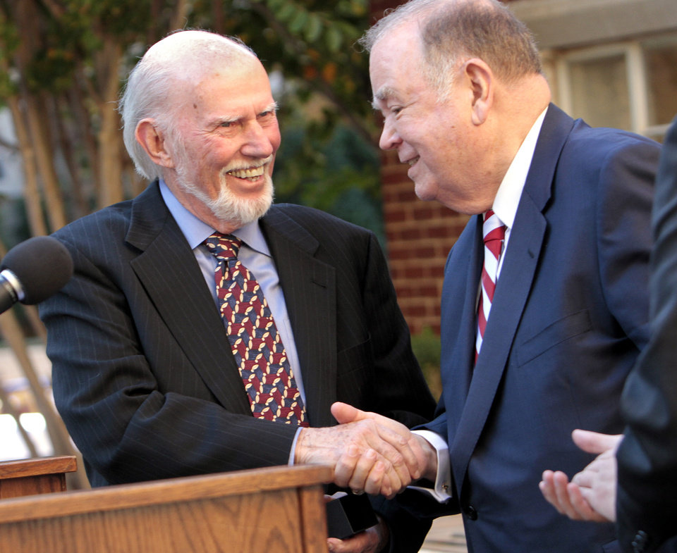Photo - Dr. Tom Boyd, left, OU philosophy professor, is honored at the annual Ring Ceremony at the University of Oklahoma (OU) on Friday, Oct. 19, 2012 in Norman, Okla.  Presenting the ring is OU President David Boren.  Photo by Steve Sisney, The Oklahoman