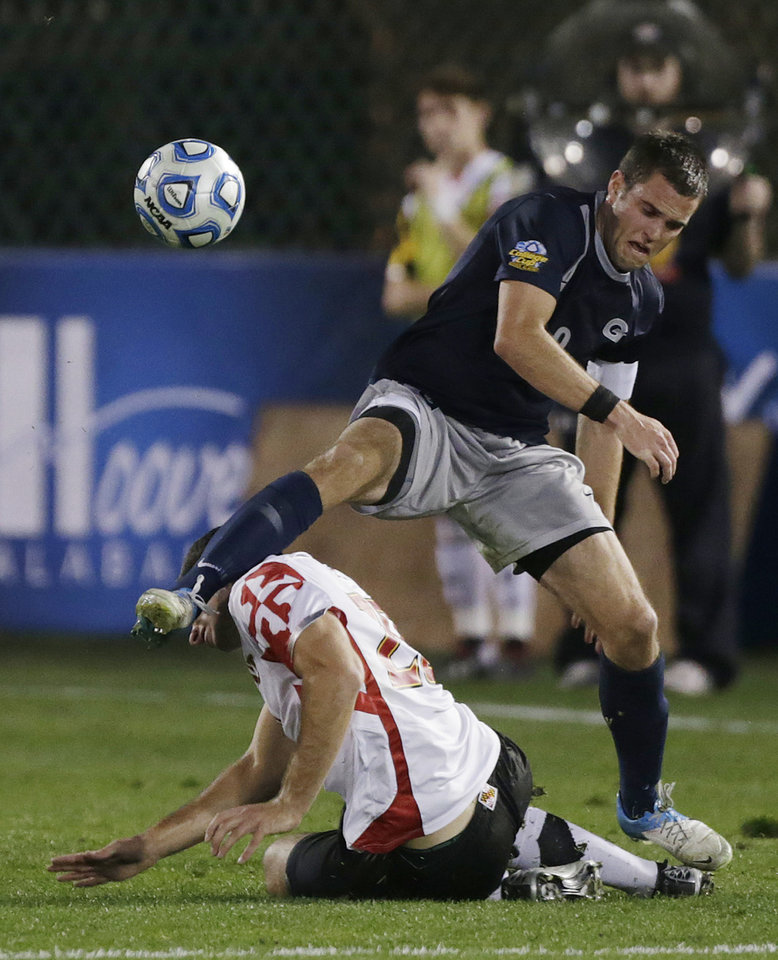Georgetown's Tommy Muller, top, battles Maryland's Jordan Tatum for the ball in the first half of a NCAA College Cup men's championship semifinal soccer match at Regions Park, Friday, Dec. 7, 2012, in Hoover, Ala. (AP Photo/Dave Martin)