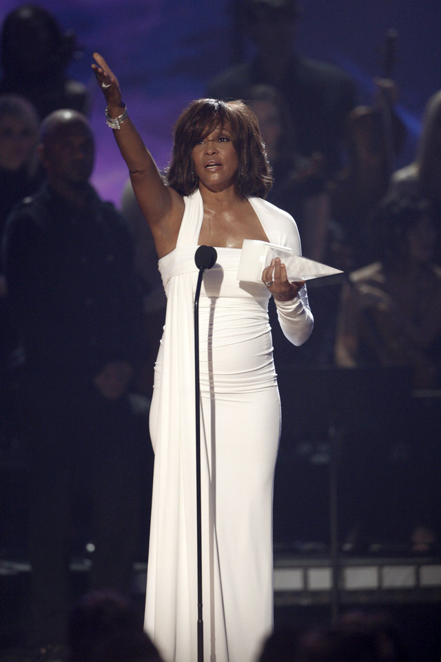 FILE - In this Nov. 22,2009, file photo, Artist Whitney Houston receives the International Artist Award onstage at the 37th Annual American Music Awards in Los Angeles. Publicist Kristen Foster said, Saturday, Feb. 11, 2012, that singer Whitney Houston has died at age 48.  (AP Photo/Matt Sayles, File)  ORG XMIT: NY204