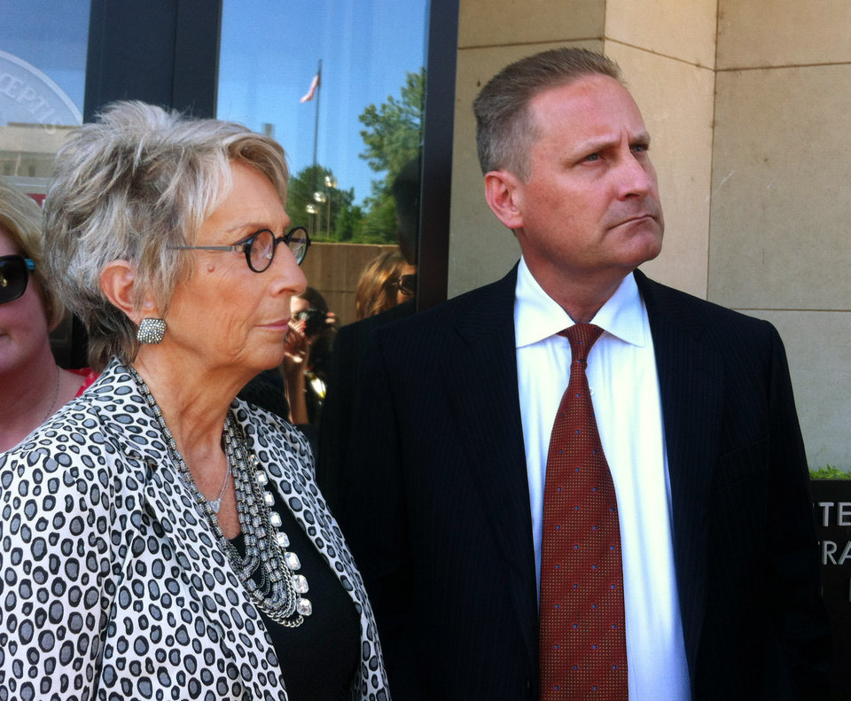 Photo -  Hobby Lobby President Steve Green and mother Barbara Green stand outside the federal courthouse July 19 in Oklahoma City. The Green family is challenging part of the Affordable Care Act that requires Hobby Lobby to offer its employees insurance coverage for emergency contraceptives. PHOTO BY BRIANNA BAILEY, THE OKLAHOMAN ARCHIVE   Brianna Bailey -