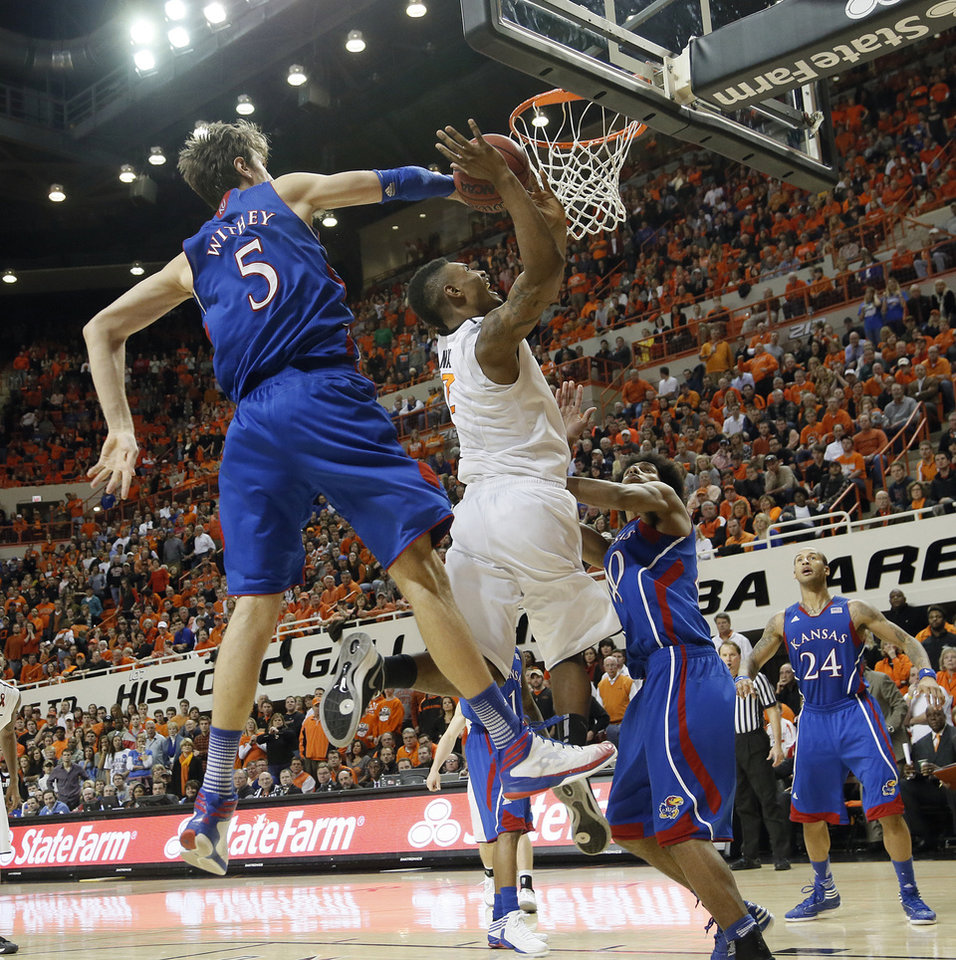 Kansas\' Jeff Withey (5) blocks a shot by Oklahoma State \'s Marcus Smart (33) during the college basketball game between the Oklahoma State University Cowboys (OSU) and the University of Kanas Jayhawks (KU) at Gallagher-Iba Arena on Wednesday, Feb. 20, 2013, in Stillwater, Okla. Photo by Chris Landsberger, The Oklahoman