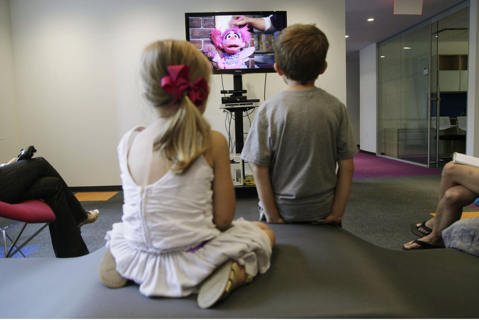Photo -   In this Sept. 5, 2012, photo, from left, Zoe Shyba, 3, and Aidan Lain, 7, play