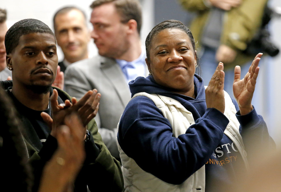 Photo - Letina McLeod, with National Association Of Blacks In Criminal Justice at Langton University, applauds after the Pardon and Parole Board read the names of 527 Oklahoma inmates recommend for commutation at the Kate Barnard Correctional Center in Oklahoma City, Friday, Nov. 1, 2019. [Sarah Phipps/The Oklahoman]