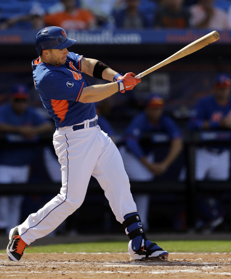 Photo - New York Mets' David Wright grounds into a double play during the fourth inning of an exhibition spring training baseball game against the St. Louis Cardinals, Friday, March 7, 2014, in Port St. Lucie, Fla. (AP Photo/Jeff Roberson)