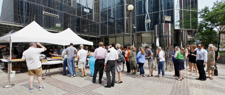 Photo - People line up to buy fresh grilled tacos at Leadership Square during the OK Chefs Relief pop-up fundraiser to benefit the ongoing recovery efforts in local storm-torn communities.  PAUL B. SOUTHERLAND - PAUL B. SOUTHERLAND