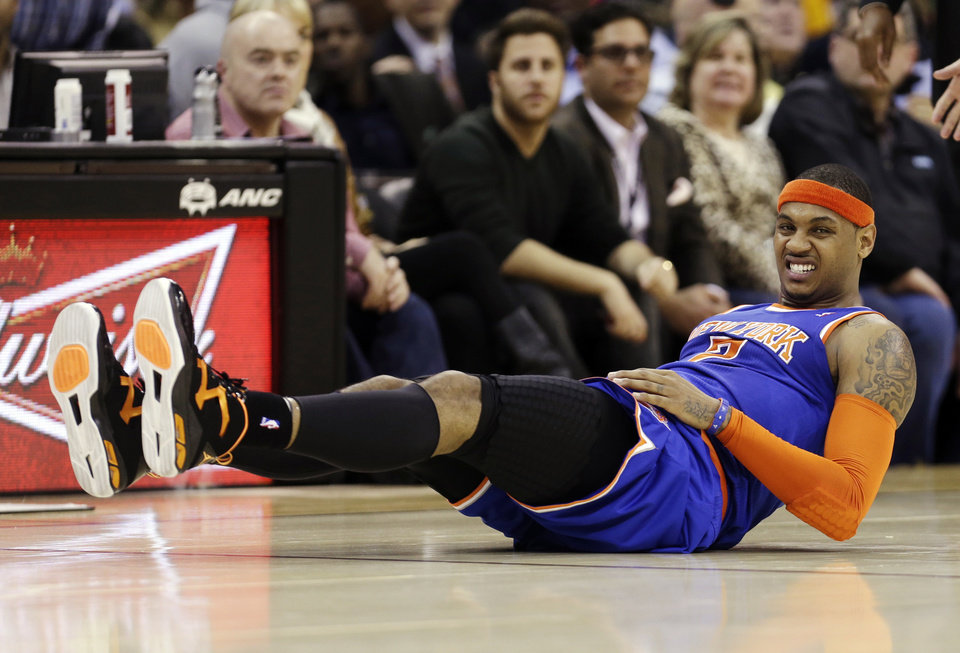 New York Knicks' Carmelo Anthony grimaces after falling in the second quarter of an NBA basketball game against the Cleveland Cavaliers, Monday, March 4, 2013, in Cleveland. (AP Photo/Tony Dejak)