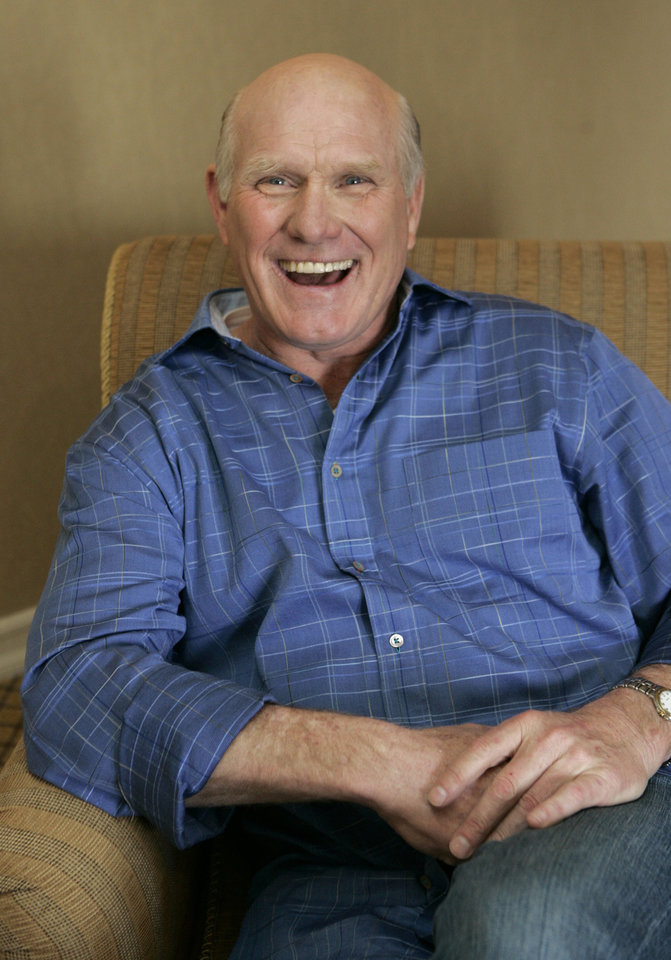 Photo - Terry Bradshaw, former football quarterback and current sports commentator, laughs during an interview in New York, Feb. 11, 2006. Bradshaw also is a featured actor in the new movie