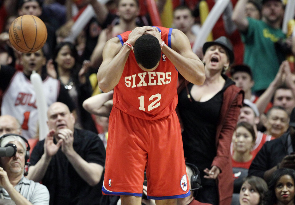 Photo -   Philadelphia 76ers guard Evan Turner (12) reacts after he fouled during the third quarter of Game 5 in an NBA basketball first-round playoff series against the Chicago Bulls in Chicago on Tuesday, May 8, 2012. The Bulls won 77-69. (AP Photo/Nam Y. Huh)
