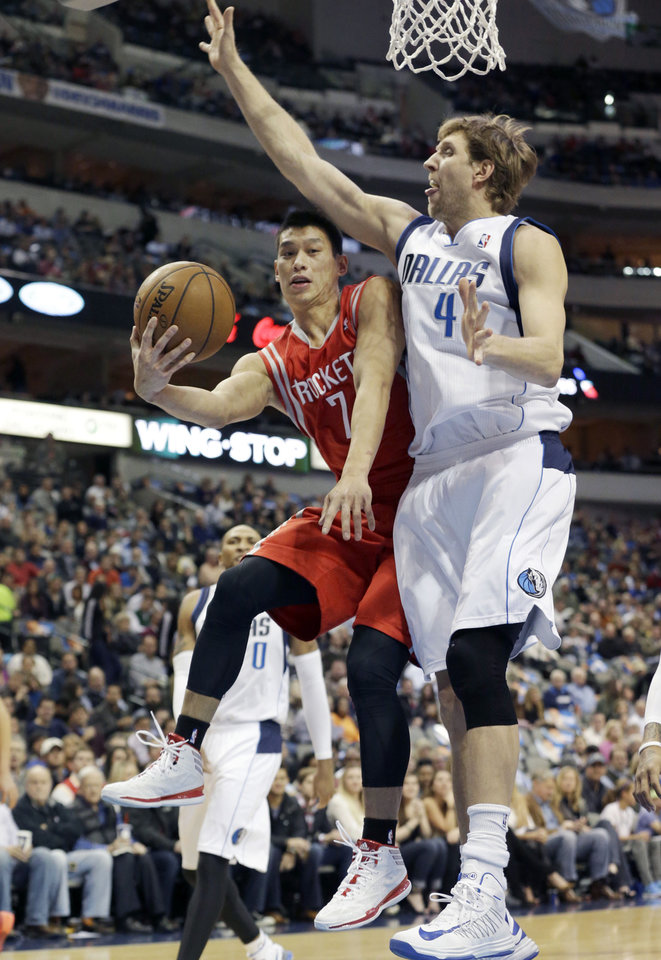 Photo - Houston Rockets point guard Jeremy Lin (7) shoots against Dallas Mavericks forward Dirk Nowitzki (41), of Germany, during the first half of an NBA basketball game Wednesday, Jan. 29, 2014, in Dallas. (AP Photo/LM Otero)