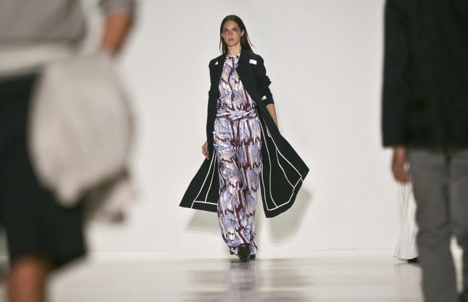 Photo - Fashion from the Richard Chai Spring 2015 collection is modeled during Fashion Week on Thursday, Sept. 4, 2014 in New York.  (AP Photo/Bebeto Matthews)