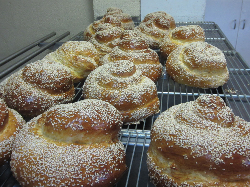 Photo - Fresh baked poppy seed challah bread cools on a rack at Emanuel Synagogue in Oklahoma City. Photo provided