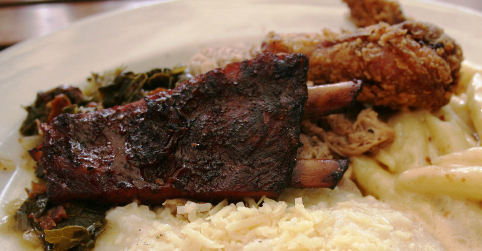 Barbecued rib, fried chicken, collard greens, macaroni and cheese and cheese grits from Zingerman's Roadhouse in Ann Arbor, Mich. <strong>DAVE CATHEY - THE OKLAHOMAN</strong>