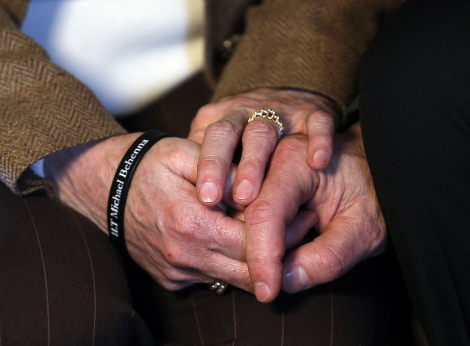 Photo - Vicki and Scott Behenna hold hands as they talk about the parole of their son, former  U.S. Army 1st Lt. Michael Behenna, on Wednesday at their home in Edmond. PHOTO BY SARAH PHIPPS, THE OKLAHOMAN  SARAH PHIPPS - THE OKLAHOMAN