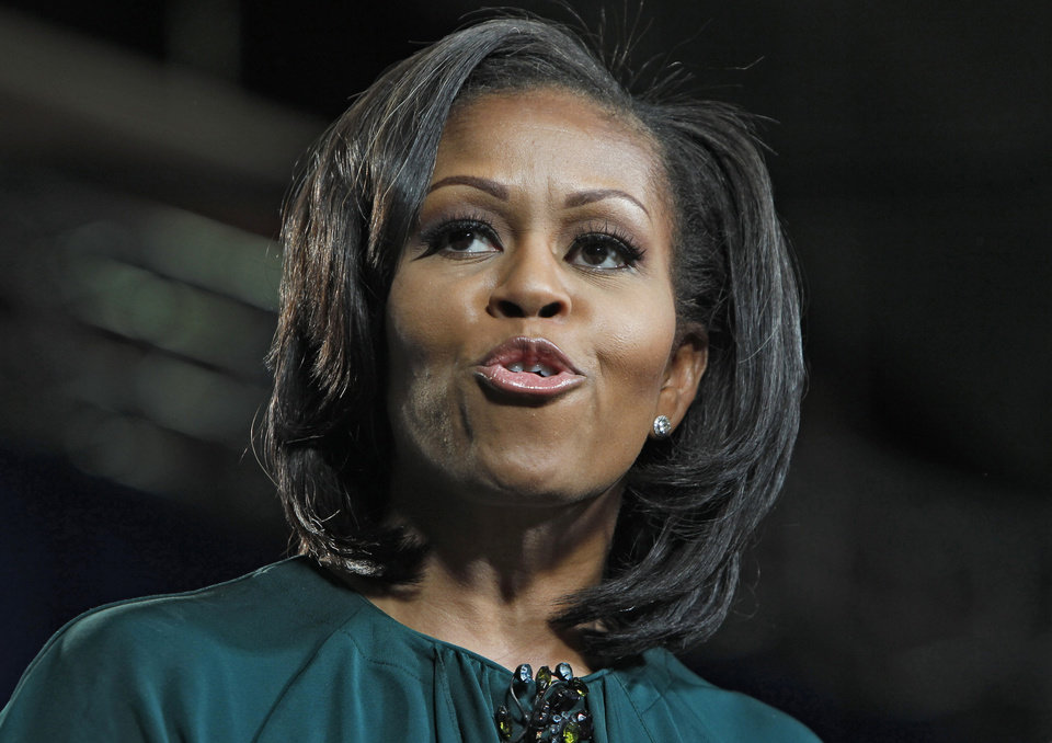 Photo -   First lady Michelle Obama campaigns for her husband, President Barack Obama, at a rally at the Douglas County Fairgrounds in Castle Rock, Colo., Thursday, Oct. 11, 2012. (AP Photo/Ed Andrieski)