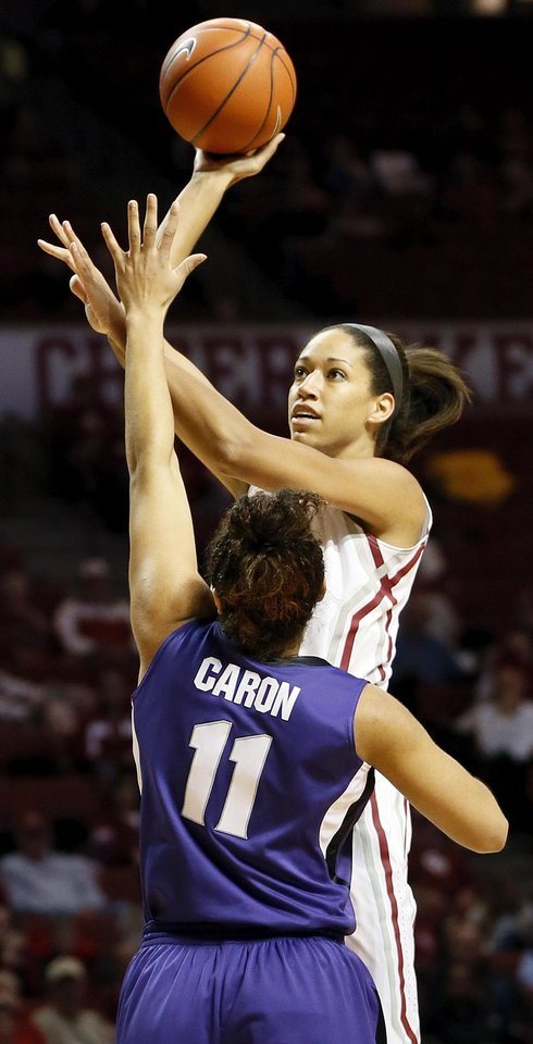 Photo - Oklahoma's Nicole Griffin (4) shoots against Kansas State's Chantay Caron (11) during an NCAA women's college basketball game between the University of Oklahoma (OU) and Kansas State at Lloyd Noble Center in Norman, Okla., Wednesday, Feb. 20, 2013. Photo by Nate Billings, The Oklahoman