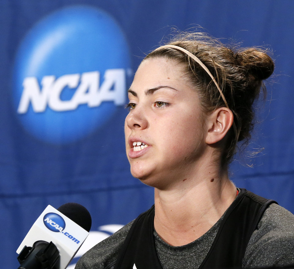 Photo - Louisville's Sara Hammond (00) speaks to the media during the press conference and practice day at the Oklahoma City Regional for the NCAA women's college basketball tournament at Chesapeake Energy Arena in Oklahoma City, Saturday, March 30, 2013. Photo by Nate Billings, The Oklahoman