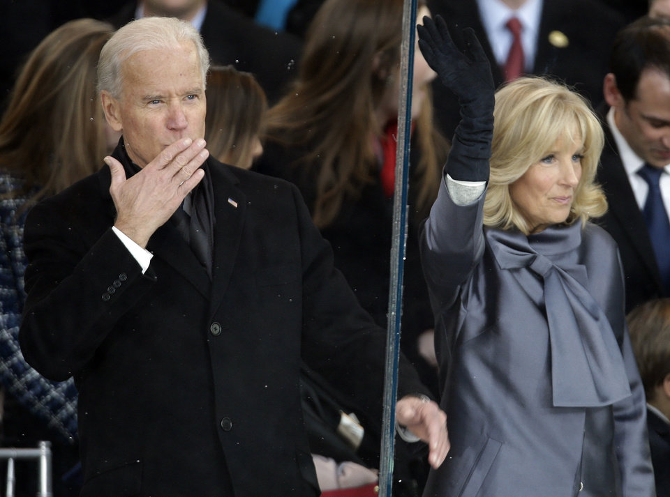 Photo - Vice President Joe Biden and his wife Jill Biden gesture to the crowd during the 57th Presidential Inauguration parade after the ceremonial swearing-in of President Barack Obama, Monday, Jan. 21, 2013, in Washington.  (AP Photo/Gerald Herbert)
