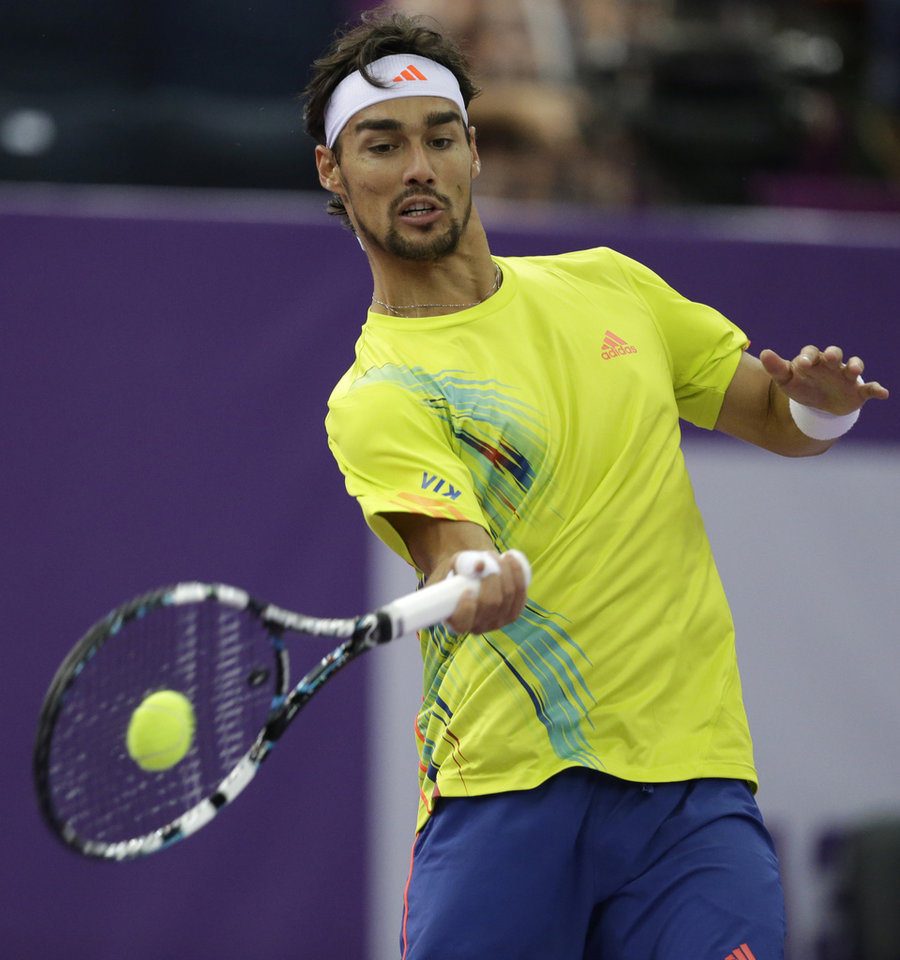 Photo -   Fabio Fognini of Italy returns the ball to Martin Klizan of Slovakia during the St. Petersburg Open ATP tennis tournament final match in St.Petersburg, Russia, Sunday, Sept. 23, 2012. (AP Photo/Dmitry Lovetsky)