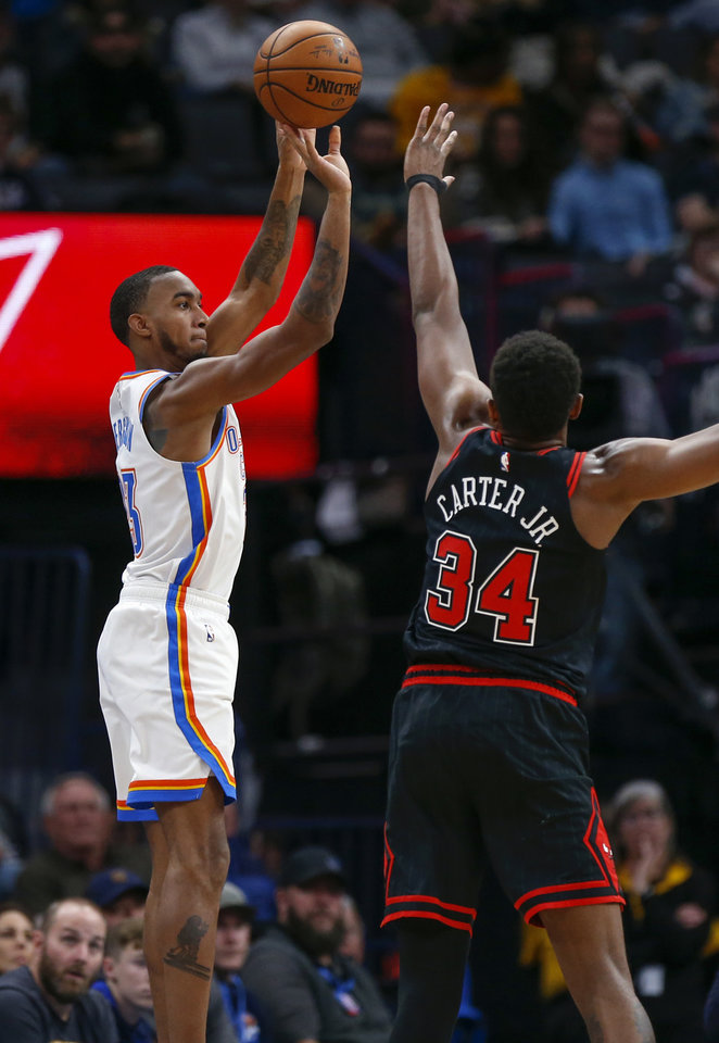 Photo - Oklahoma City's Terrance Ferguson (23) shoots as Chicago's Wendell Carter Jr. (34) defends in the third quarter during an NBA basketball game between the Oklahoma City Thunder and Chicago Bulls at Chesapeake Energy Arena in Oklahoma City, Monday, Dec. 16, 2019. Oklahoma City won 109-106. [Nate Billings/The Oklahoman]