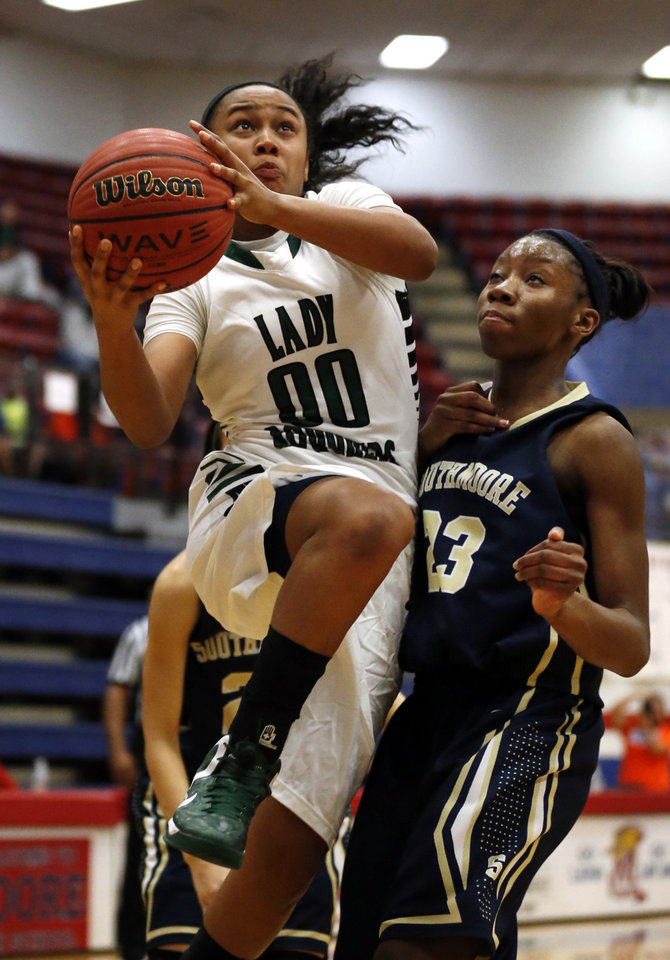 Muskogee's Kelsey McClure (00) drives past Southmoore's Serithia Hwkins (23) in the girls championship game of the John Nobles Invitational Tournament on Saturday, Jan. 26, 2013  in Moore, Okla. Photo by Steve Sisney, The Oklahoman