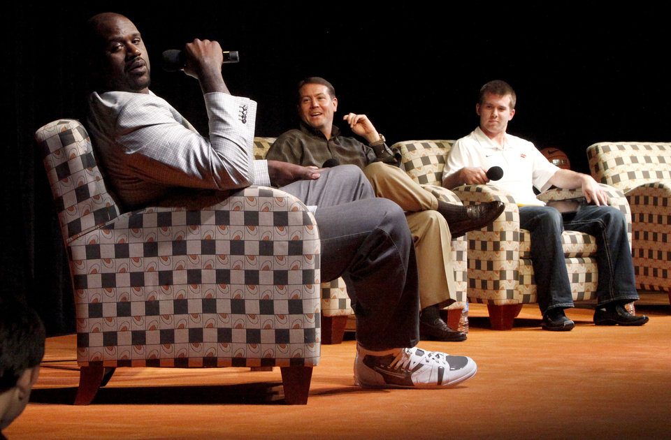 Photo - Former NBA star Shaquille O'Neal sits on stage with Oklahoma State basketball coach Travis Ford and OSU basketball player Keiton Page during a question and answer session at Gallagher-Iba Arena on the campus of Oklahoma State University in Stillwater, Okla., Tuesday, April 3, 2012. Oklahoma State University's Student Government Association Speakers Board hosted the event. Photo by Bryan Terry, The Oklahoman