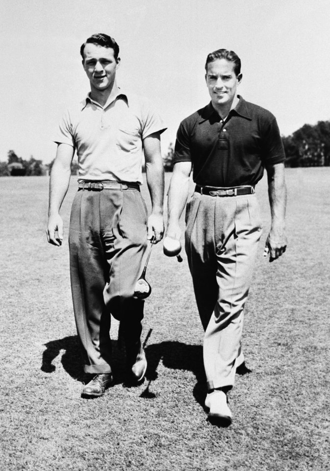 Photo - FILE - In this April 21, 1949 file photo, Arnold Palmer, left,  and Frank Stranahan walk together at the 49th North and South amateur golf tournament in Pinehurst, N.C. Stranahan, a runner-up at two majors as an amateur and a fitness fanatic before it became vogue in golf, died Sunday, June 23, 2013. He was 90. (AP Photo/File)