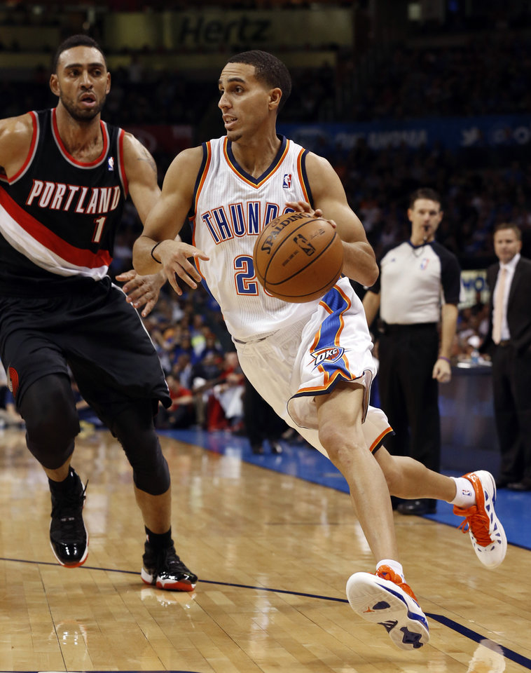 Photo - Thunder's Kevin Martin (23) drives past Jared Jeffries (1) as the Oklahoma City Thunder play the Portland Trail Blazers in NBA basketball at the Chesapeake Energy Arena in Oklahoma City, on Friday, Nov. 2, 2012.  Photo by Steve Sisney, The Oklahoman