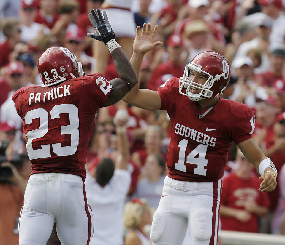 Photo - Oklahoma's Allen Patrick (23) and Sam Bradford (14) celebrate after Patrick's touchdown in the first half during the University of Oklahoma Sooners (OU) college football game against the Utah State University Aggies (USU) at the Gaylord Family -- Oklahoma Memorial Stadium in Norman, Okla., on Saturday, Sept. 15, 2007.  By NATE BILLINGS, The Oklahoman  ORG XMIT: KOD