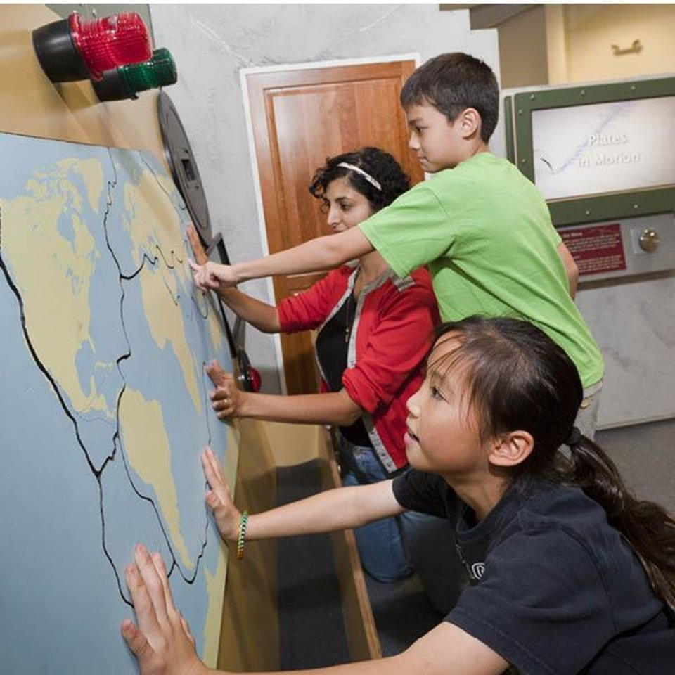 Photo -  Children explore an interactive map at