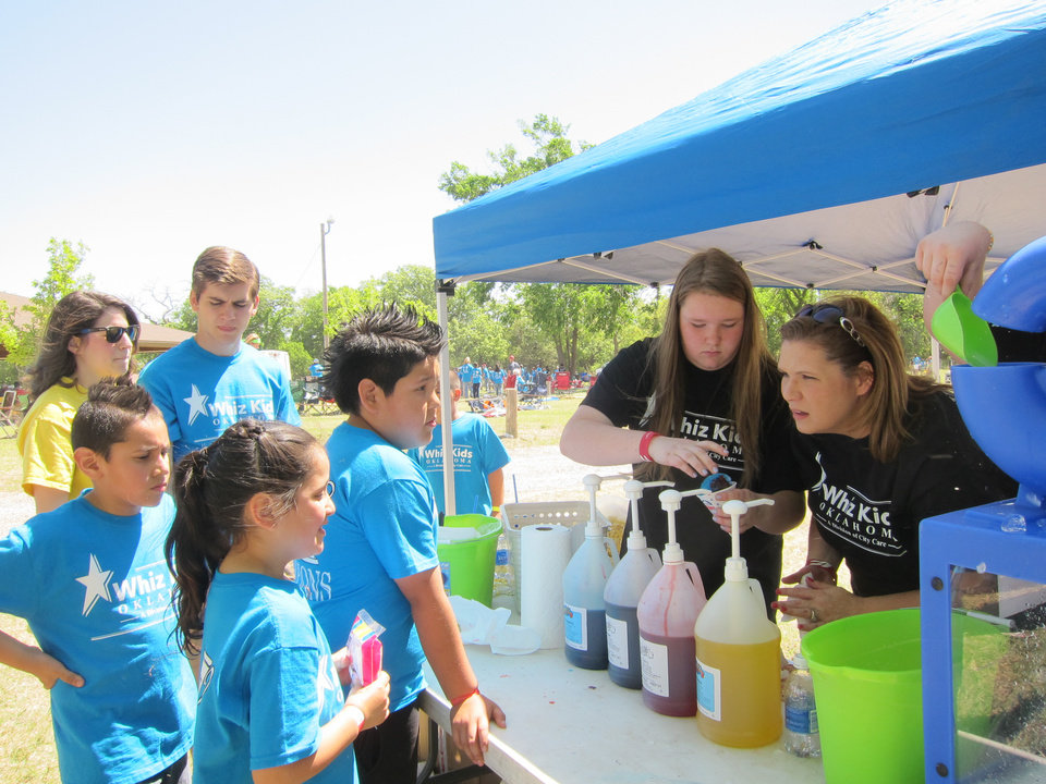 "Photo -  Children line up to order snow cones during the recent Whiz Kids ""Spring Fling"" celebration at Crystal Lake in Oklahoma City. Photo by Carla Hinton, The Oklahoman"