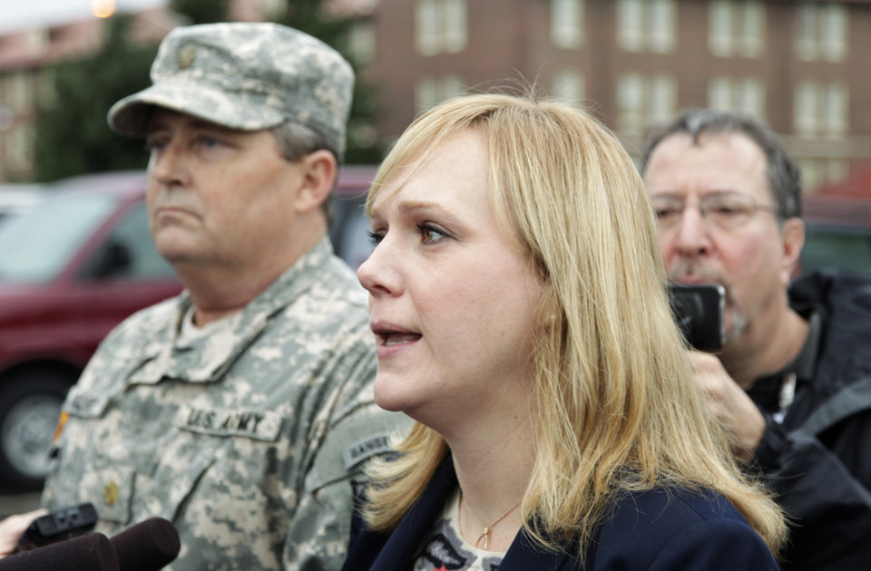 Photo -   Emma Scanlan, right, the civilian defense attorney for U.S. Army Staff Sgt. Robert Bales, talks to reporters, Tuesday Nov. 13, 2012, as she stands with Bales' military defense attorney, Maj. Gregory Malson, left, on Joint Base Lewis McChord in Washington state, where a preliminary hearing ended Tuesday for Bales, who is accused of 16 counts of premeditated murder and six counts of attempted murder for a pre-dawn attack on two villages in Kandahar Province in Afghanistan last March. (AP Photo/Ted S. Warren)
