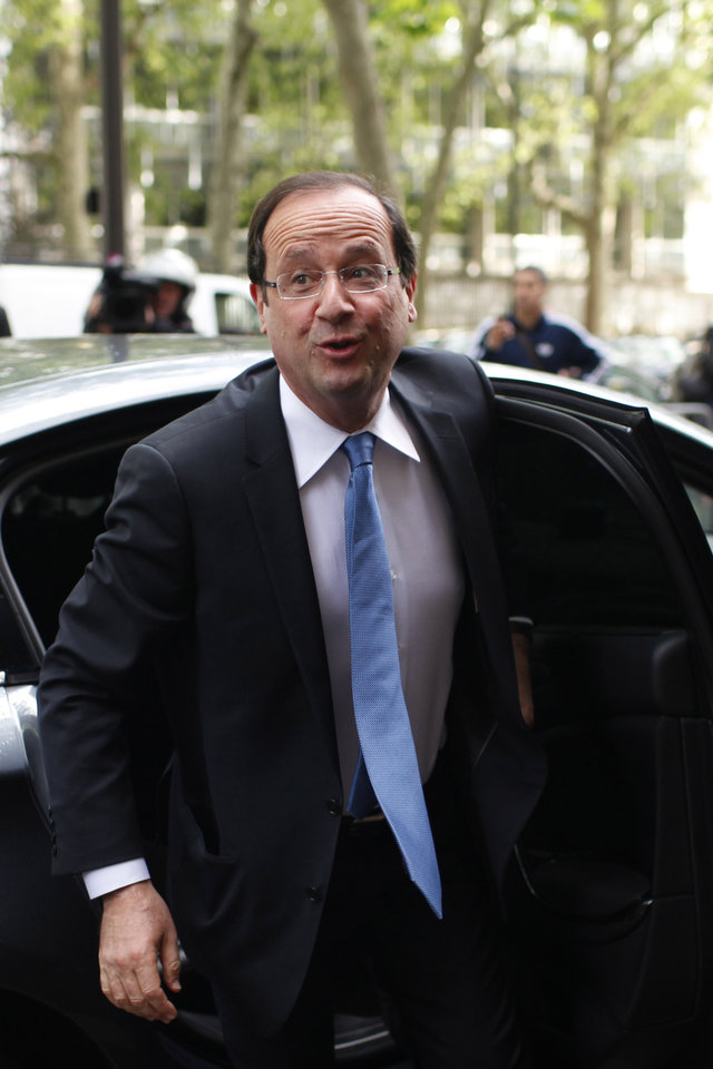 President-elect Francois Hollande arrives at the Socialist Party headquarters in Paris Wednesday May 9, 2012. After winning the French Presidential Election, Hollande seems set to embark on a whirlwind introduction to international politics, with critical visits already being scheduled to Berlin, the US, and two top international summits. (AP Photo/Thibault Camus)