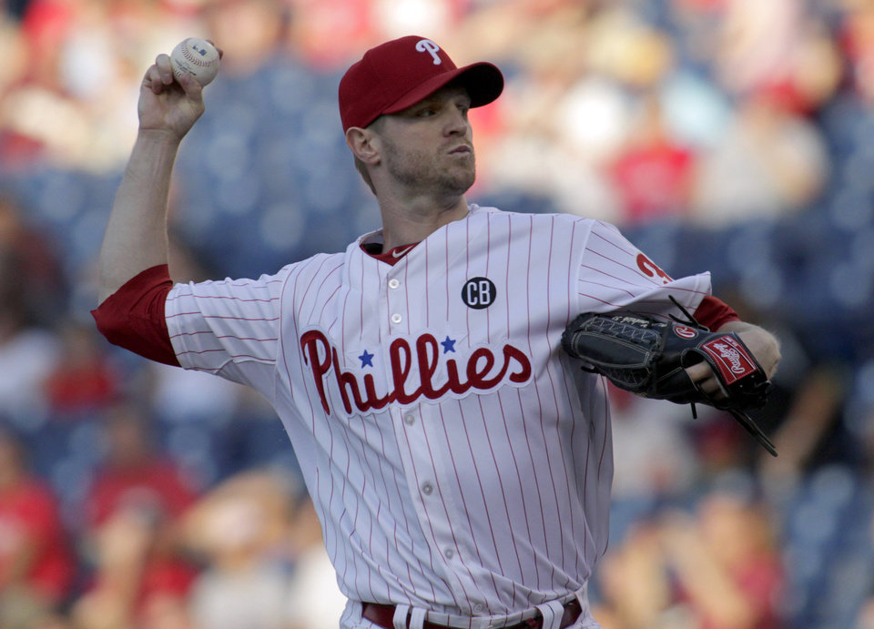 Photo - Philadelphia Phillies starting pitcher Kyle Kendrick throws against the Arizona Diamondbacks in the first inning of a baseball game on Friday, July 25, 2014, in Philadelphia. (AP Photo/H. Rumph Jr)
