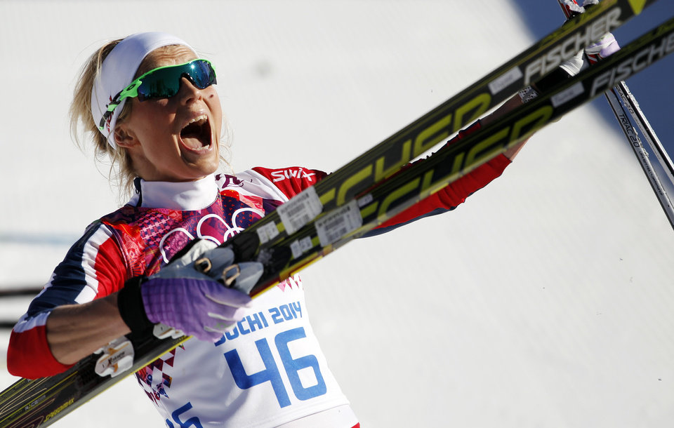 Photo - Norway's Therese Johaug celebrates winning the bronze during the women's 10K classical style cross-country race at the 2014 Winter Olympics, Thursday, Feb. 13, 2014, in Krasnaya Polyana, Russia. (AP Photo/Matthias Schrader, File)