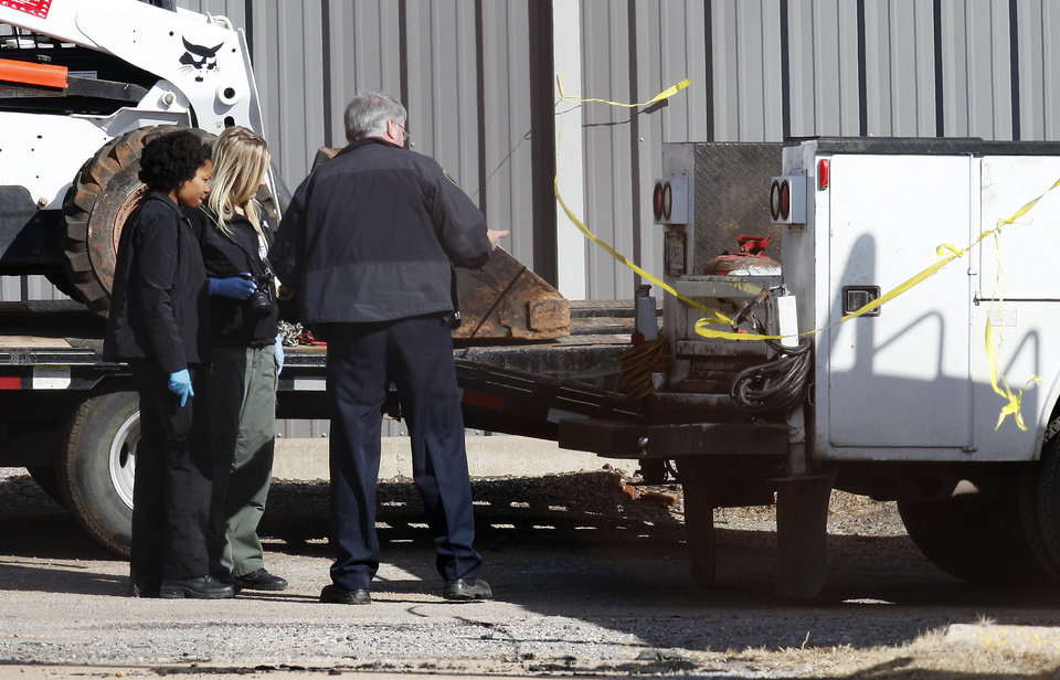 Oklahoma City police and the medical examiner's office investigate a fatality after a truck backed over a man in the yard at Burns Paving Company, 105 NE 44 in Oklahoma City Monday, Feb. 12, 2013. Photo by Paul B. Southerland, The Oklahoman <strong>PAUL B. SOUTHERLAND - PAUL B. SOUTHERLAND</strong>