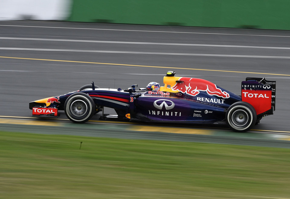 Photo - Red Bull driver Daniel Ricciardo of Australia controls his car on turn 10 during the third practice session at Albert Park ahead of the Australian Formula One Grand Prix in Melbourne, Australia, Saturday, March 15, 2014. (AP Photo/Andy Brownbill)