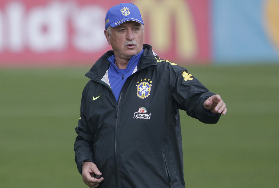 Photo - Brazil's coach Luiz Felipe Scolari directs his players during a training session of the Brazilian national socccer team at the Granja Comary training center in Teresopolis, Brazil, Monday, June 9, 2014. Brazil plays in group A of the 2014 soccer World Cup. (AP Photo/Andre Penner)